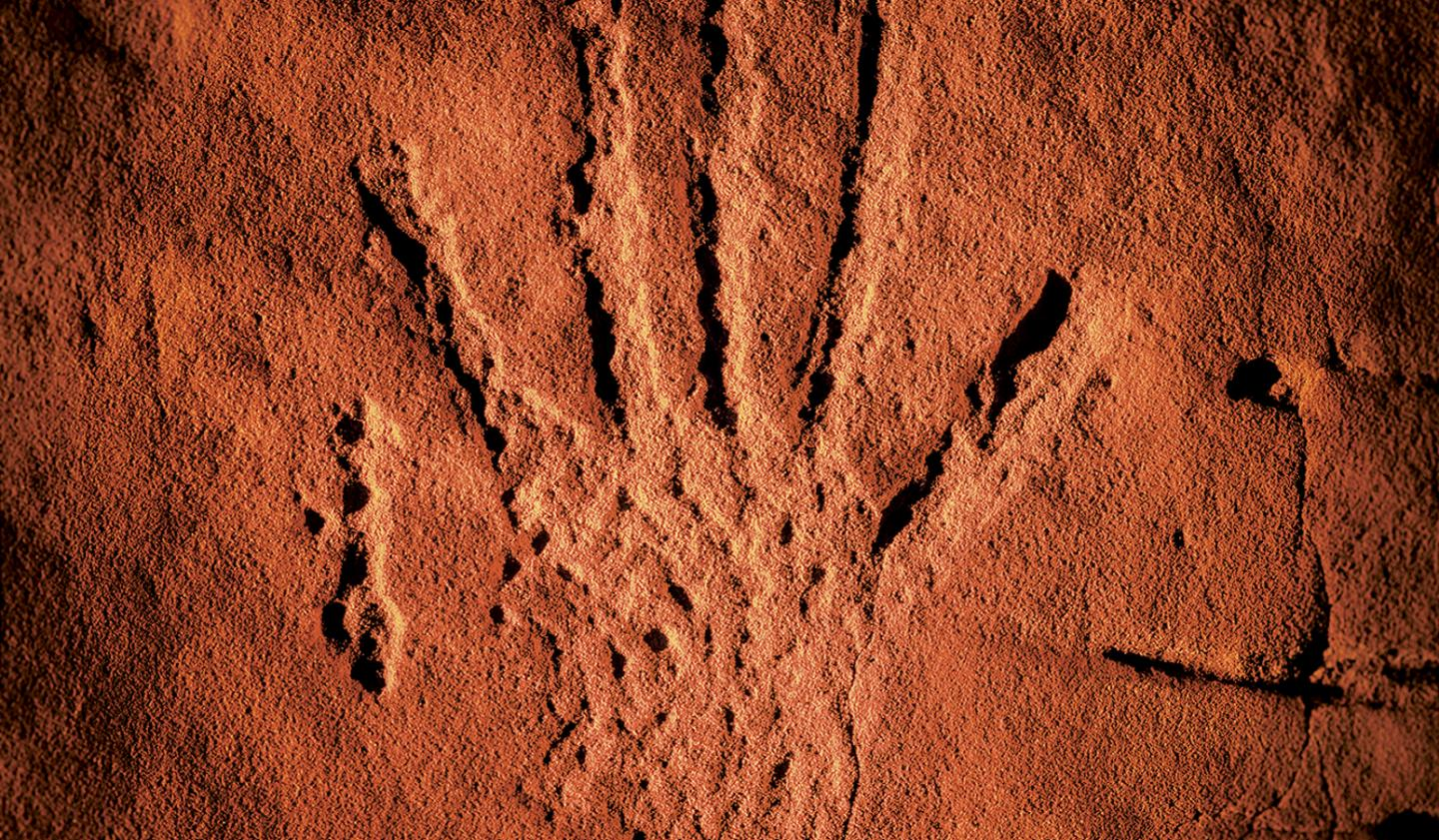 Pecking, rock art, hand print