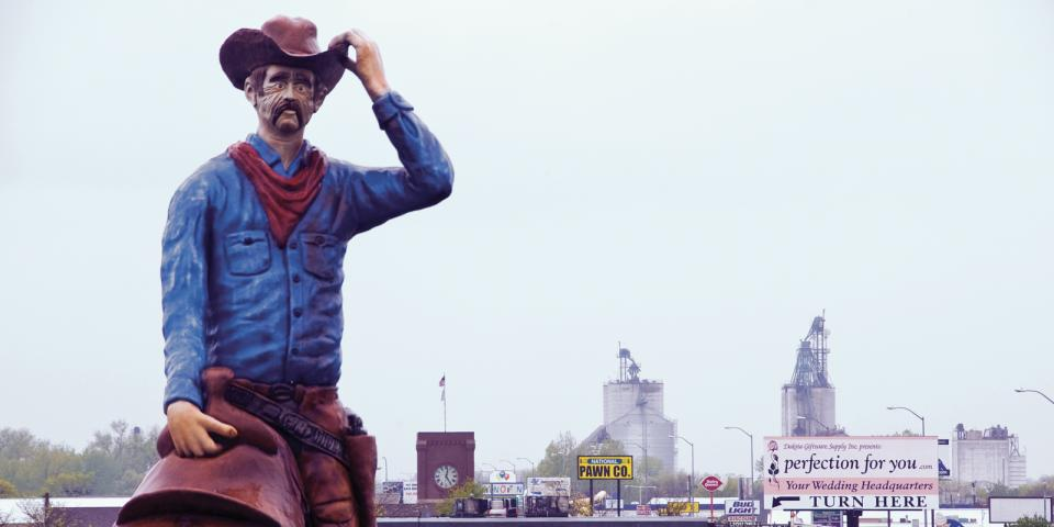 The Cowboy, a fiberglass Watertown landmark since the 1970s, greets travelers from a rooftop perch on the Cowboy convenience store at the corner of Highways 81 and 212, one of South Dakota's busiest intersections.