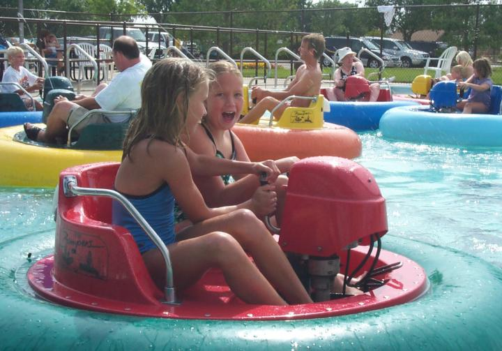 People riding the bumper boats at Wylie Thunder Road in Aberdeen, SD.
