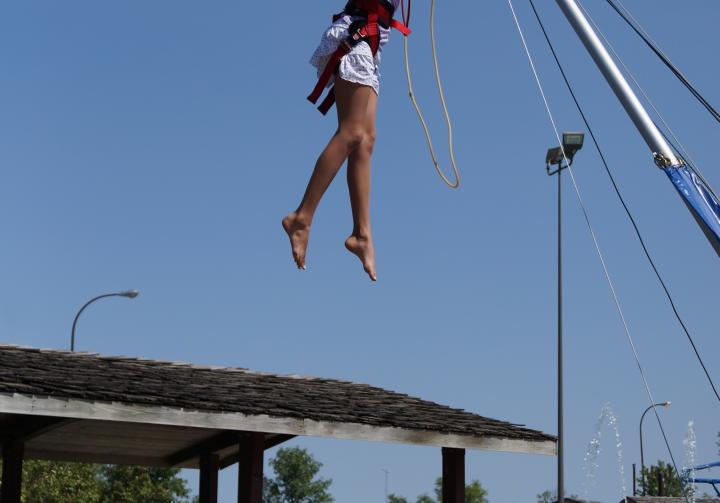 Girl jumping on Euro Bungy at Wylie Thunder Road in Aberdeen, SD.